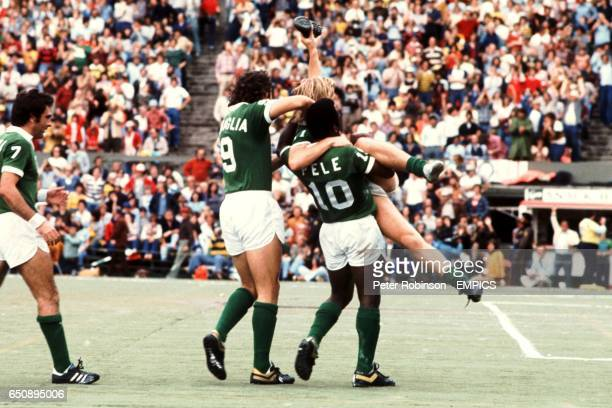 New York Cosmos' Steve Hunt is congratulated by teammates Giorgio Chinaglia and Pele on scoring a goal with his left foot