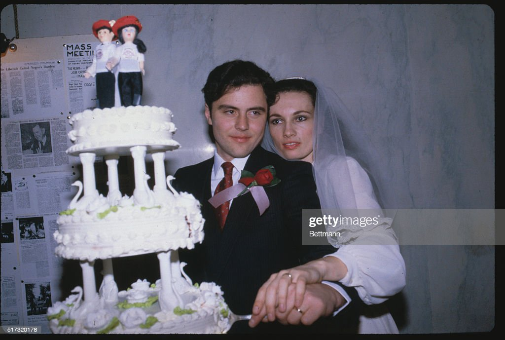 Curtis Shim left founder of the Guardian Angles crime patrols and his bride Lisa Evans cut the cake after their marriage Evers a black belt karate...