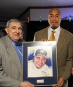 New York Daily News cartoonist Bill Gallo giving the Pride of the Yankees Award to Bernie Williams April 12th 2010