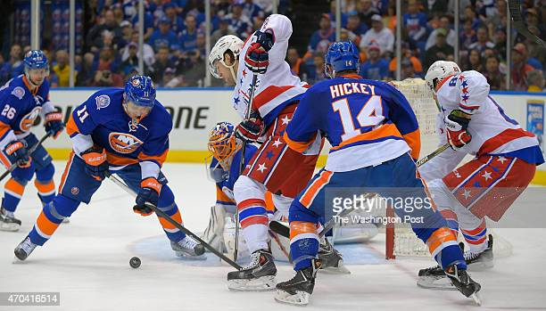 New York defenseman Lubomir Visnovsky left knocks a rebound of of New York goalie Jaroslav Halak center away from a shot by Washington right wing Tom...