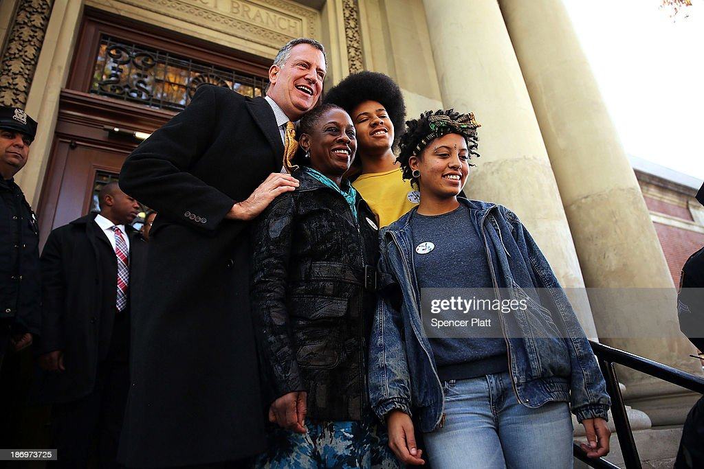 New York Democratic mayoral candidate <a gi-track='captionPersonalityLinkClicked' href=/galleries/search?phrase=Bill+de+Blasio&family=editorial&specificpeople=6224514 ng-click='$event.stopPropagation()'>Bill de Blasio</a> poses with his family, wife <a gi-track='captionPersonalityLinkClicked' href=/galleries/search?phrase=Chirlane+McCray&family=editorial&specificpeople=8014891 ng-click='$event.stopPropagation()'>Chirlane McCray</a>, son <a gi-track='captionPersonalityLinkClicked' href=/galleries/search?phrase=Dante+de+Blasio&family=editorial&specificpeople=11364181 ng-click='$event.stopPropagation()'>Dante de Blasio</a> and daughter <a gi-track='captionPersonalityLinkClicked' href=/galleries/search?phrase=Chiara+de+Blasio&family=editorial&specificpeople=11364182 ng-click='$event.stopPropagation()'>Chiara de Blasio</a> after voting at a public library branch on Election Day on November 5, 2013 in the Brooklyn borough of New York City. De Blasio leads in the polls over his challenger Republican mayoral candidate Joe Lhota by double digit points.