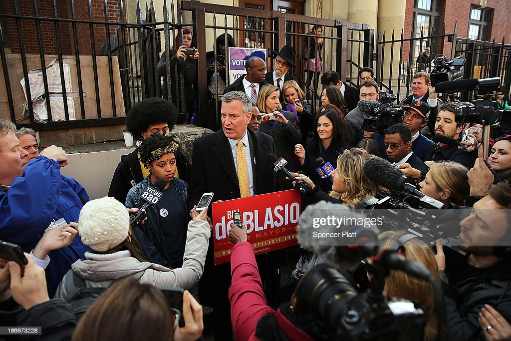 New York Democratic mayoral candidate Bill de Blasio speaks to the media with his family after voting at a public library branch on Election Day on November 5, 2013 in the Brooklyn borough of New York City. De Blasio has a double digit lead over his challenger Republican mayoral candidate Joe Lhota