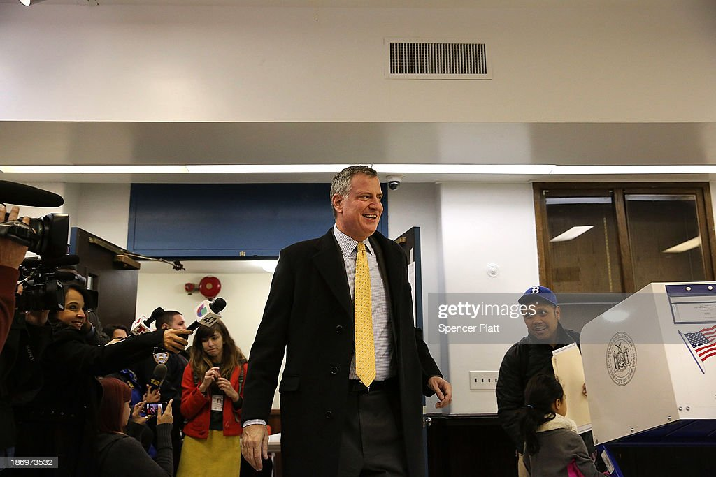 New York Democratic mayoral candidate Bill de Blasio walks into his local precinct to vote at a public library branch on Election Day on November 5, 2013 in the Brooklyn borough of New York City. De Blasio holds a significant lead in the polls over his challenger Republican mayoral candidate Joe Lhota.