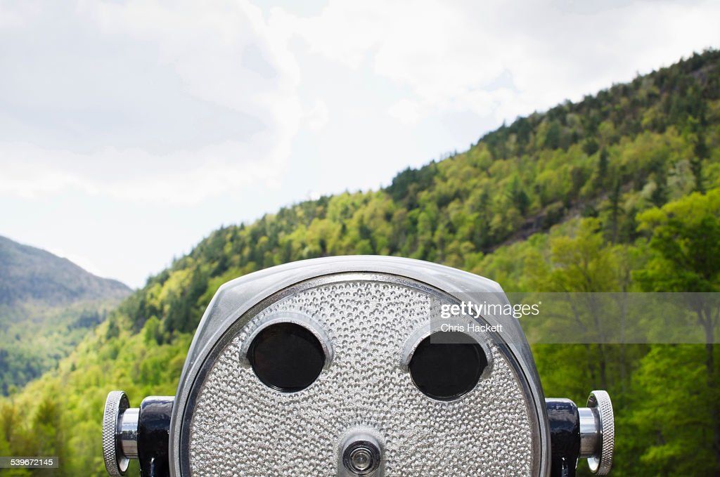 USA, New York, Essex County, Wilmington, Close-up view of coin-operated binoculars against background of wooded Adirondack Mountains