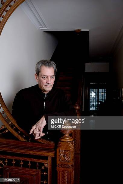 Paul Auster author of 'Invisible' in ed Actes Sud receives 'Paris Match' with him at his home in Brooklyn threequarter plan laying at the foot of the...