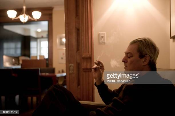 Paul Auster author of 'Invisible' in ed Actes Sud receives 'Paris Match' with him at his home in Brooklyn profile plane closing his eyes while...