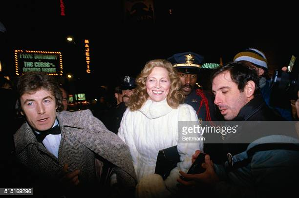 Film star Faye Dunaway escorted by her boyfriend Terry O'Neil leaves theater here following her opening in the play The Curse of the Aching Heart It...
