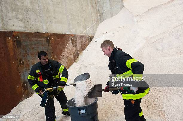 New York Fire Department firefighters stock up on salt before New York City Mayor Bill De Blasio speaks about the city's preparedness for an upcoming...
