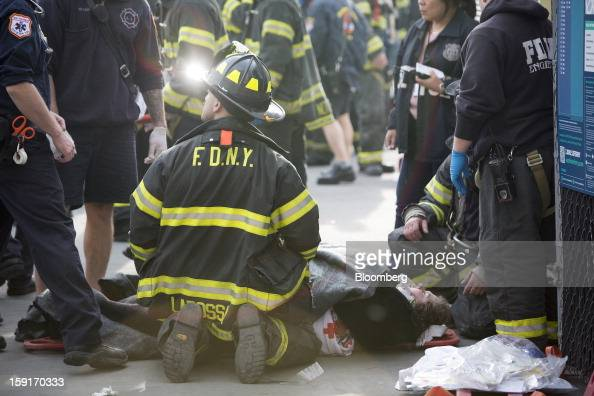 New York Fire Department firefighters tend to injured ferry commuters on stretchers in New York US on Wednesday Jan 9 2013 A Seastreak commuter ferry...