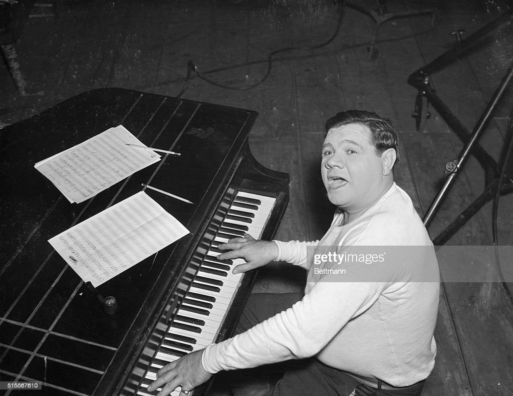 From Clouter To Crooner Babe Ruth is shown at the piano as he rehearsed for his forthcoming flicker Home Run on the Keys which he is making for...