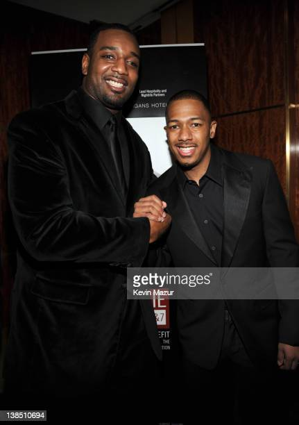New York Giant Chris Canty and Nick Cannon attend JayZ's performance at Carnegie Hall to Benefit the United Way of New York City and the Shawn Carter...