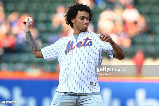 New York Giant first round pick Evan Engram throws out the first pitch prior to th egam ebetween the New York Mets and the Washington Nationals at...