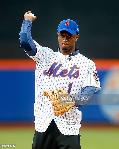 New York Giants 2016 first round draft pick Eli Apple throws out the ceremonial first pitch before a game between the New York Mets and the...