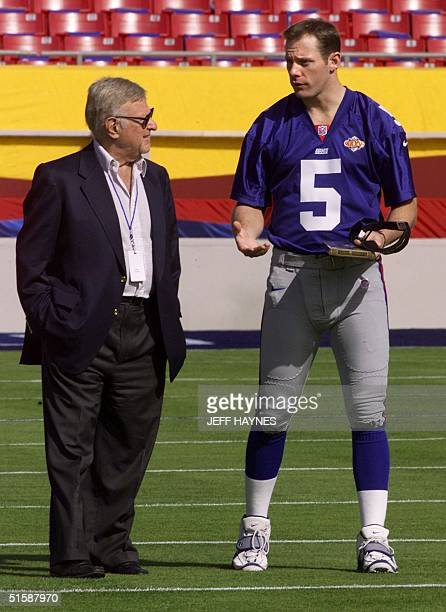 New York Giants Chairman and CEO Preston Robert Tisch talks with quarterback Kerry Collins 23 January 2001 during media day for Super Bowl XXXV at...