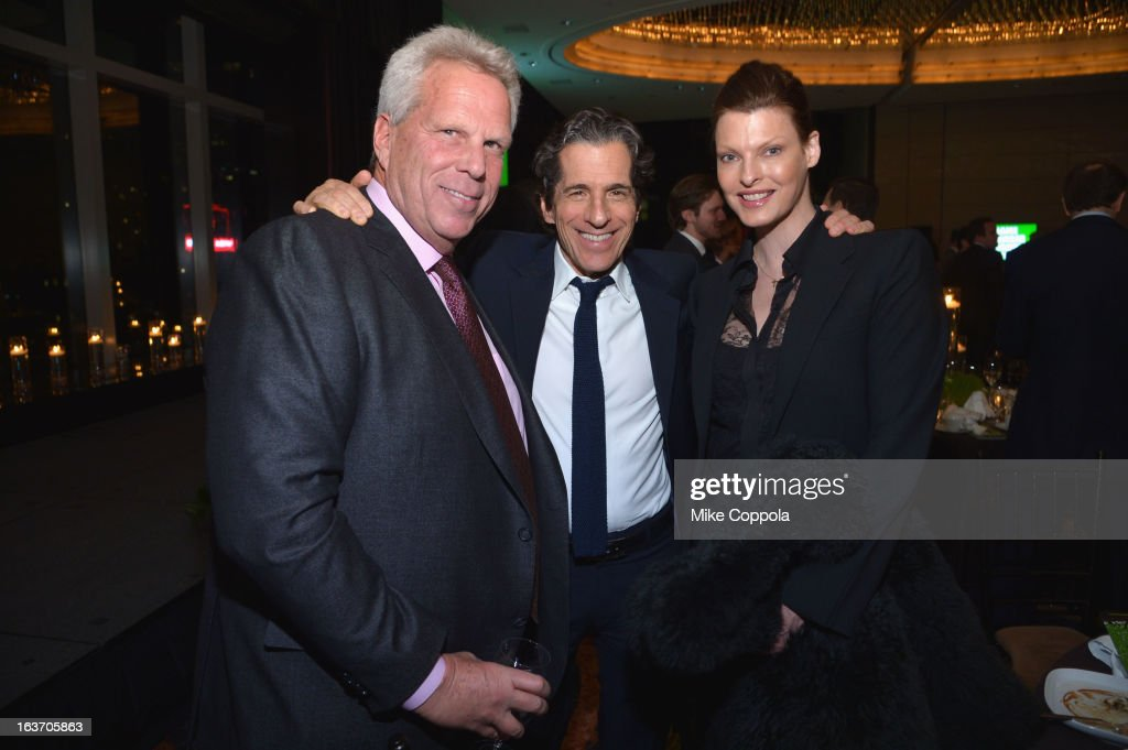 New York Giants chairman Steve Tisch, Peter Morton, and Linda Evangelista attend the 2013 Natural Resources Defense Council Game Changer Awards at the Mandarin Oriental Hotel on March 14, 2013 in New York City.