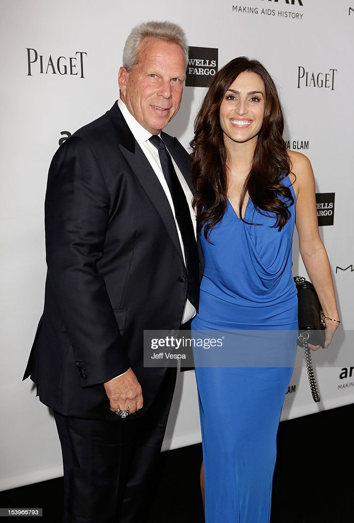 New York Giants Chairman/Executive VP <a gi-track='captionPersonalityLinkClicked' href=/galleries/search?phrase=Steve+Tisch&family=editorial&specificpeople=235783 ng-click='$event.stopPropagation()'>Steve Tisch</a> and Nicole Butler arrive at amfAR's Inspiration Gala at Milk Studios on October 11, 2012 in Los Angeles, California.