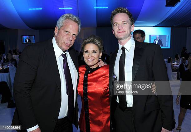 New York Giants coowner Steve Tisch Chef Cat Cora and actor Neil Patrick Harris attend the 20th Annual Elton John AIDS Foundation Academy Awards...