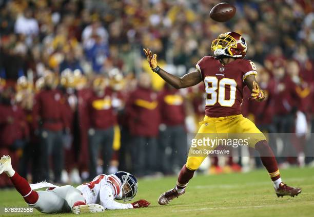 New York Giants defensive back Donte Deayon breaks up a pass to Washington Redskins wide receiver Jamison Crowder during a NFL game between the...