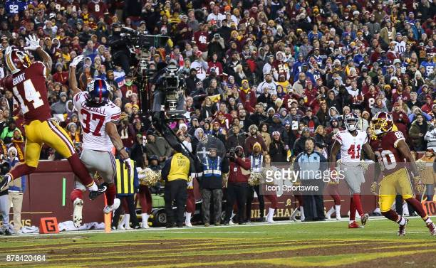 New York Giants defensive back Ross Cockrell defends as Washington Redskins wide receiver Ryan Grant can't hold onto the ball in the end zone during...