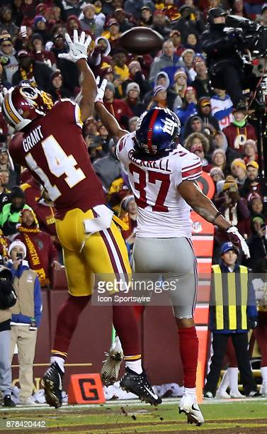 New York Giants defensive back Ross Cockrell tips the ball meant for Washington Redskins wide receiver Ryan Grant in the end zone during a NFL game...