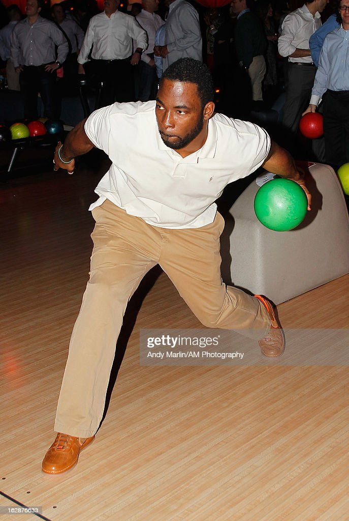 New York Giants defensive end Justin Tuck bowls during the John Starks Foundation Celebrity Bowling Tournament on February 25, 2013 in New York City.