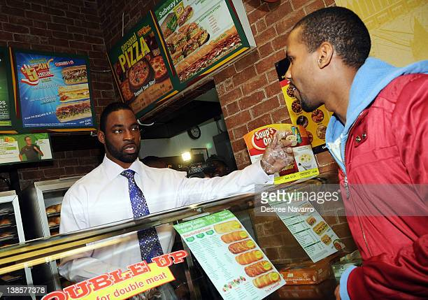 New York Giants Defensive End Justin Tuck takes orders for sandwiches to celebrate FebruANY at Subway Restaurant on February 9 2012 in New York City