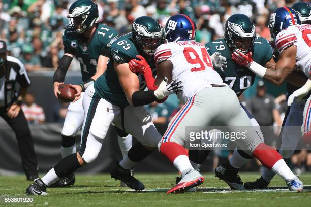 New York Giants defensive tackle Dalvin Tomlinson is blocked by Philadelphia Eagles offensive tackle Lane Johnson during a NFL football game between...