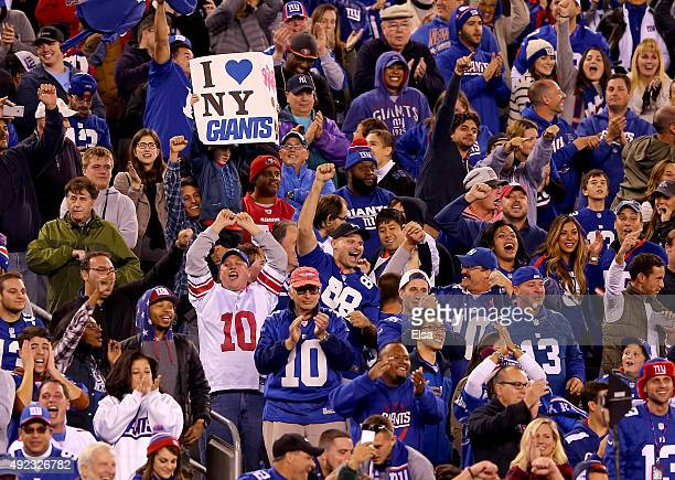 New York Giants fans celebrate after Larry Donnell scored the game winning touchdown in the fourth quarter against the San Francisco 49ers at MetLife...