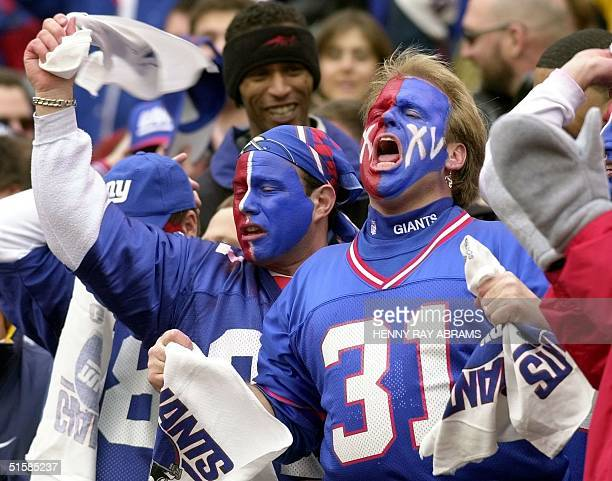 New York Giants fans celebrate during the first half of the NFC Championship game against the Minnesota Vikings at Giants Stadium 14 December 2001 in...