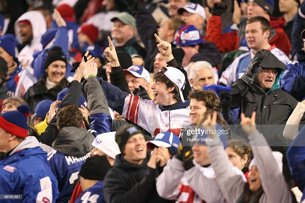 New York Giants fans cheer after a touchdown during a game against the Philadelphia Eagles on December 13, 2009 at Giants Stadium in East Rutherford, New Jersey. The Eagles won 45-38.
