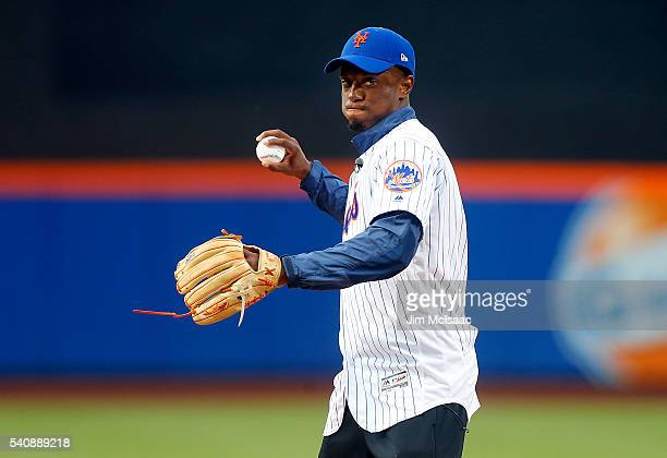 New York Giants first round draft pick Eli Apple throws out the ceremonial first pitch before a game between the New York Mets and the Pittsburgh...
