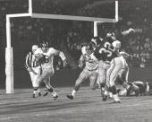 New York Giants Hall of Fame running back Frank Gifford runs behind guard Darrell Dees on a sweep in a 3124 win over the Los Angeles Rams on...