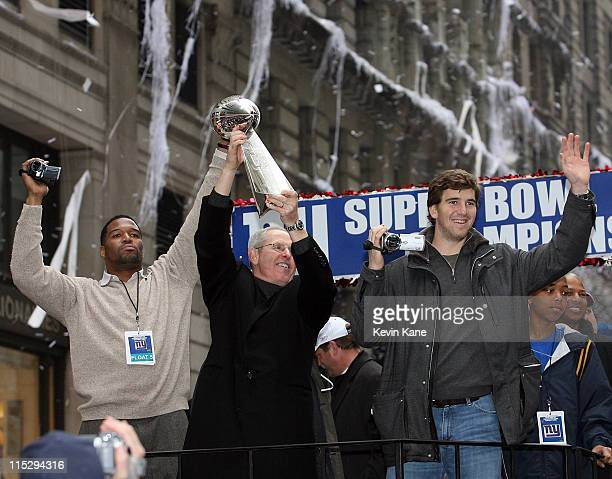 New York Giants Michael StrahanGiants Head Coach Tom Coughlin and Giants Quarterback Eli Manning during the New York Giants Victory Parade in lower...