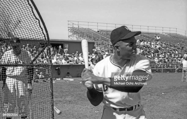 New York Giants outfielder Willie Mays attends batting practice during spring training in March 1957 in Phoenix Arizona