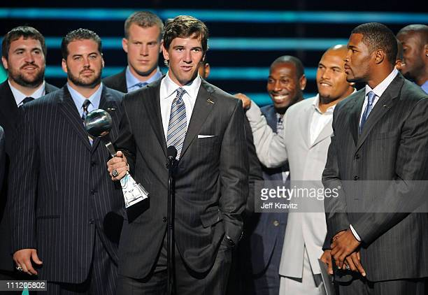 NFL New York Giants Player Eli Manning with teammates accept the Best Game award onstage during the 2008 ESPY Awards held at NOKIA Theatre LA LIVE on...