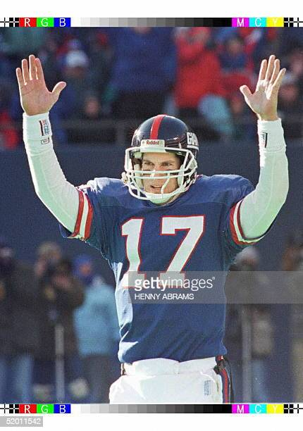 New York Giants' quarterback Dave Brown celebrates after he handed the ball off to teammate Charles Way who scored the Giants' first touchdown in the...