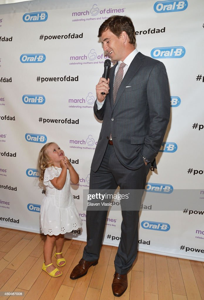 New York Giants' quarterback <a gi-track='captionPersonalityLinkClicked' href=/galleries/search?phrase=Eli+Manning&family=editorial&specificpeople=202013 ng-click='$event.stopPropagation()'>Eli Manning</a> and daughter Ava celebrate Father's Day at Studio Arte on June 11, 2014 in New York City.