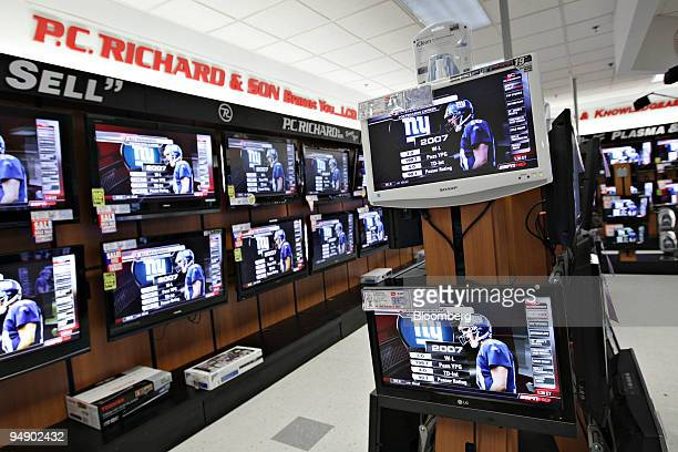 New York Giants quarterback Eli Manning appears on television screen inside a PC Richard Sons store in New York US on Thursday Jan 31 2008 With...