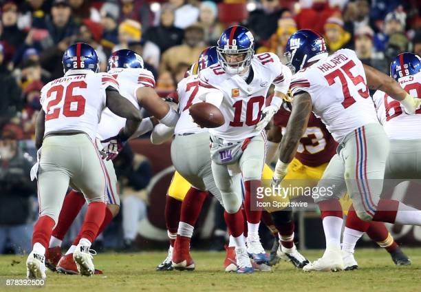 New York Giants quarterback Eli Manning hands off to running back Orleans Darkwa during a NFL game between the Washington Redskins and the New York...