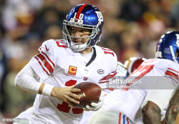 New York Giants quarterback Eli Manning looks to make a hand off during a NFL game between the Washington Redskins and the New York Giants on...