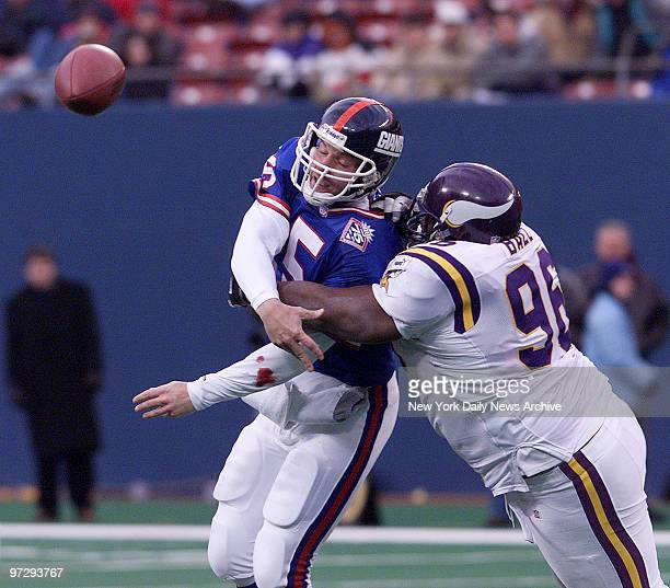 New York Giants' quarterback Kerry Collins gets off pass as he's hit by Minnesota Vikings' defender The Vikings won 34 17 at Giants Stadium