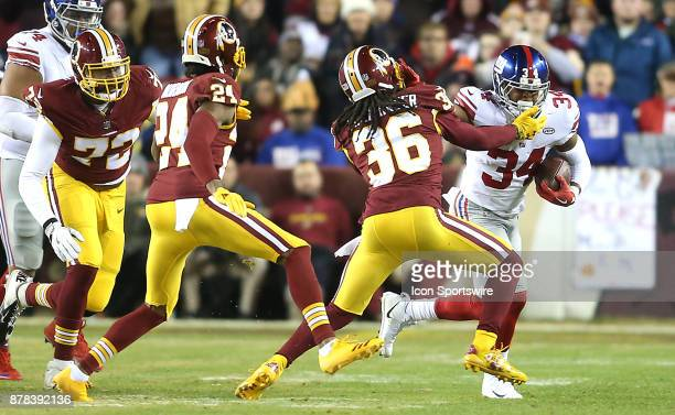New York Giants running back Shane Vereen fends off a tackle by Washington Redskins free safety DJ Swearinger during a NFL game between the...