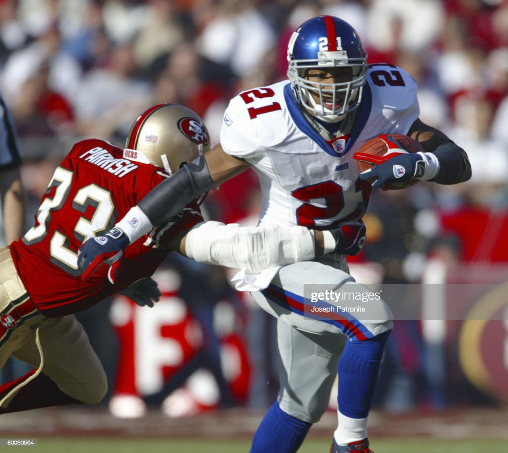 New York Giants running back Tiki Barber fights off defensive back Tony Parrish during a 3938 loss to the San Francisco 49ers in a 2002 NFC Wild Card...