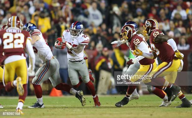 New York Giants running back Wayne Gallman finds a gap in the Redskins defense during a NFL game between the Washington Redskins and the New York...