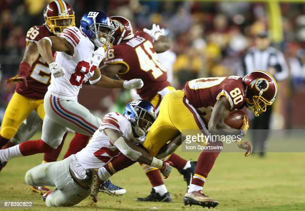 New York Giants running back Wayne Gallman holds onto Washington Redskins wide receiver Jamison Crowder during a NFL game between the Washington...