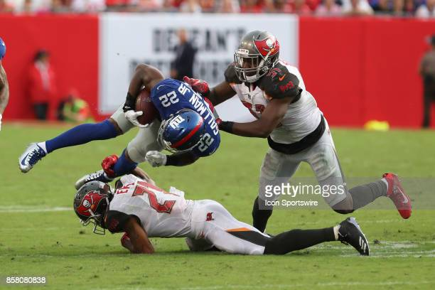 New York Giants running back Wayne Gallman is tackled by Tampa Bay Buccaneers safety Justin Evans and Tampa Bay Buccaneers outside linebacker Kendell...