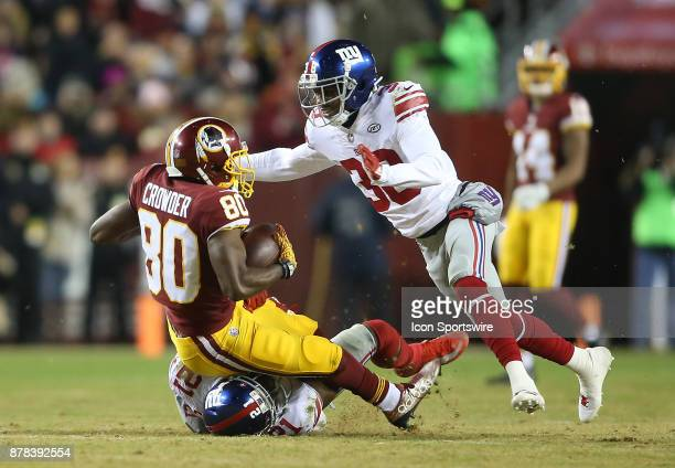 New York Giants strong safety Landon Collins and defensive back Donte Deayon upend Washington Redskins wide receiver Jamison Crowder during a NFL...