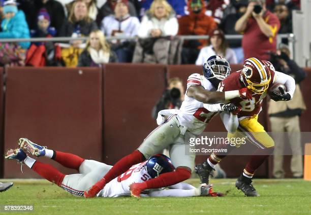 New York Giants strong safety Landon Collins hauls down Washington Redskins tight end Niles Paul during a NFL game between the Washington Redskins...