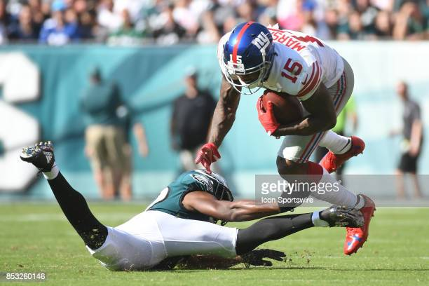 New York Giants wide receiver Brandon Marshall is upended by Philadelphia Eagles cornerback Jalen Mills during a NFL football game between the New...