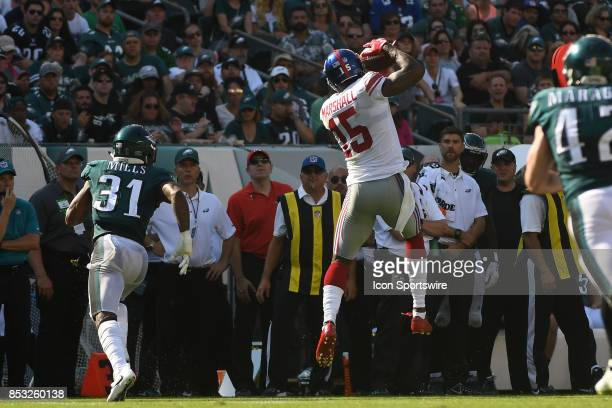 New York Giants wide receiver Brandon Marshall makes a leaping reception during a NFL football game between the New York Giants and the Philadelphia...